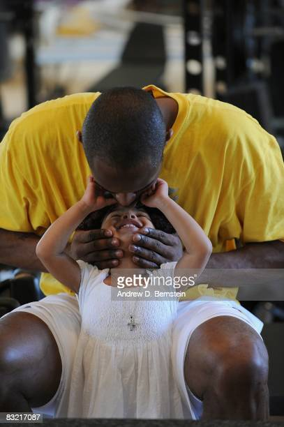 Kobe Bryant of the Los Angeles Lakers kisses his daughter Gianna Bryant during a photo session on March 29 2008 at his home in Newport Beach...