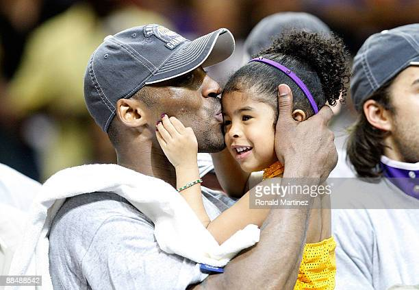 Kobe Bryant of the Los Angeles Lakers kisses his daughter, Gianna, after the Lakers defeated the Orlando Magic 99-86 in Game Five of the 2009 NBA...