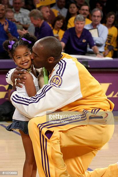 Kobe Bryant of the Los Angeles Lakers kisses his daughter Natalia after receiving the MVP trophy before the start of Game Two of the Western...