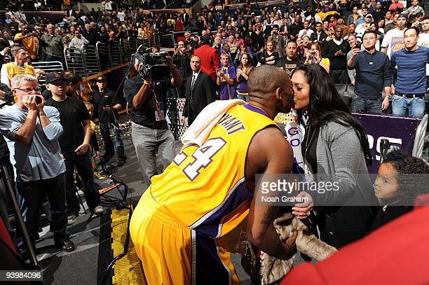 Kobe Bryant of the Los Angeles Lakers kisses his wife, Vanessa following his team's victory over the Miami Heat at Staples Center on December 4, 2009...