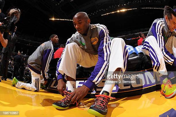 Kobe Bryant of the Los Angeles Lakers laces up his shoes before taking on the New York Knicks at Staples Center on December 25 2012 in Los Angeles...