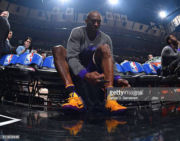 Kobe Bryant of the Los Angeles Lakers laces up his sneakers prior to the game against the Chicago Bulls on February 21 2016 at the United Center in...