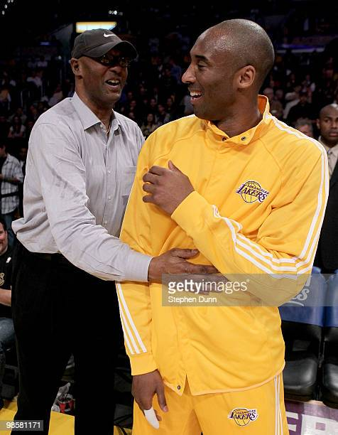 Kobe Bryant of the Los Angeles Lakers laughs with father Joe Jelly Bean Bryant before playing the Oklahoma City Thunder during Game Two of the...