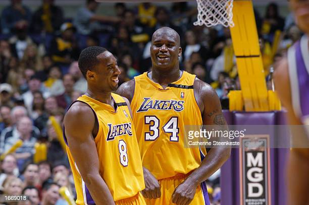 Kobe Bryant of the Los Angeles Lakers laughs with teammate Shaquille O'Neal during the NBA game against the Milwaukee Bucks at Staples Center on...
