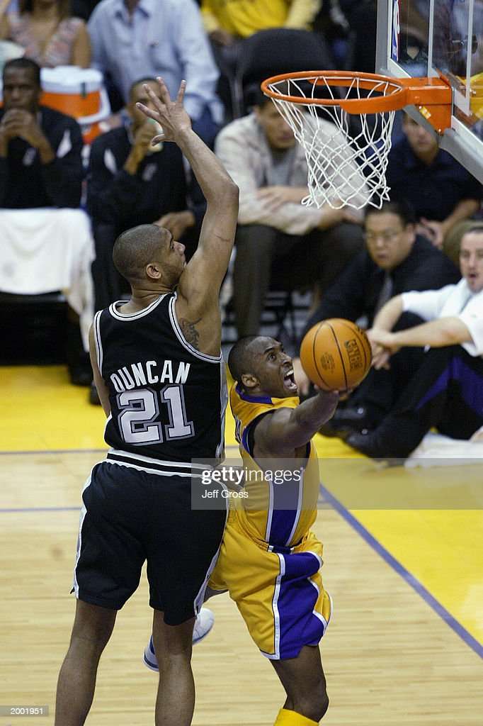 548cbeea9 Bryant shoots past Duncan. LOS ANGELES - MAY 9  Kobe Bryant  8 of the Los  Angeles Lakers lays a shot up past Tim Duncan  21 of the San Antonio Spurs  ...