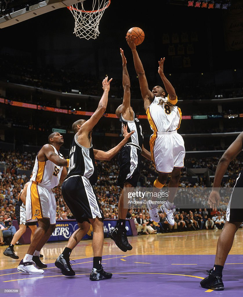 fda16a925 Bryant layup against Bowen and Duncan. LOS ANGELES - MAY 11  Kobe Bryant  8  of the Los Angeles Lakers lays the ball ...