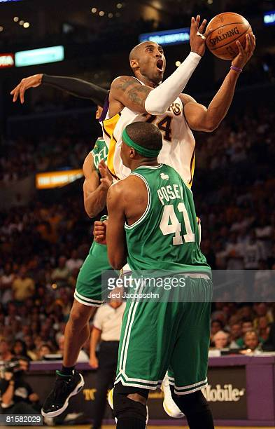 Kobe Bryant of the Los Angeles Lakers lays the ball up over James Posey and Ray Allen of the Boston Celtics in Game Five of the 2008 NBA Finals on...