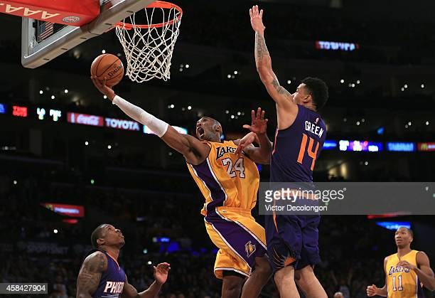 Kobe Bryant of the Los Angeles Lakers lays up a shot against Gerald Green of the Phoenix Suns in the second half during the NBA game at Staples...