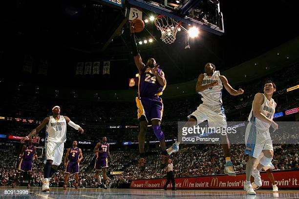 Kobe Bryant of the Los Angeles Lakers lays up a shot against Marcus Camby the Denver Nuggets in Game Four of the Western Conference Quarterfinals...