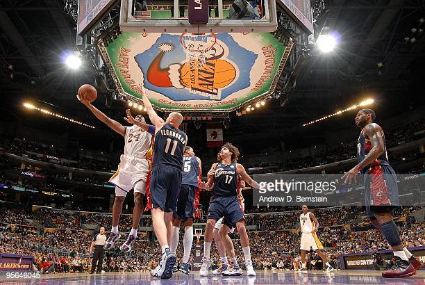 Kobe Bryant of the Los Angeles Lakers lays up a shot against Zydrunas Ilgauskas of the Cleveland Cavaliers during the game on December 25, 2009 at...