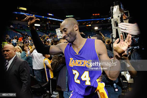 Kobe Bryant of the Los Angeles Lakers leaves the court after the game against the Minnesota Timberwolves on December 14 2014 at Target Center in...