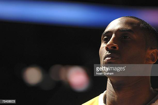 Kobe Bryant of the Los Angeles Lakers lines up during the National Anthem before the game against the Boston Celtics on February 23 2007 at Staples...