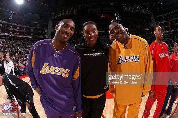 Kobe Bryant of the Los Angeles Lakers Lisa Leslie of the Los Angeles Sparks and former Los Angeles Lakers guard Earvin Magic Johnson pose for a photo...