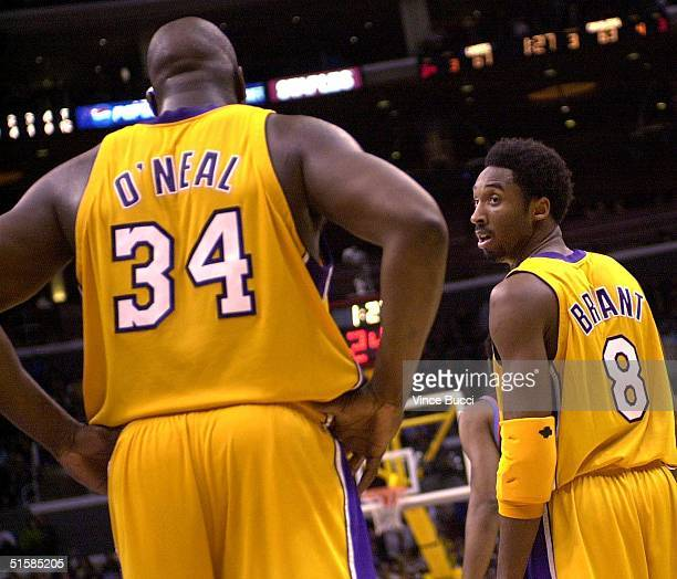 Kobe Bryant of the Los Angeles Lakers looks back toward teammate Shaquille O'Neal during their game against the Cleveland Cavaliers 12 January 2001...