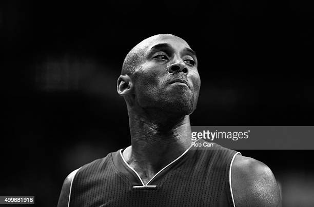 Kobe Bryant of the Los Angeles Lakers looks on against the Washington Wizards in the first half at Verizon Center on December 2 2015 in Washington DC...