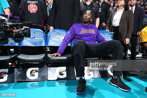 Kobe Bryant of the Los Angeles Lakers looks on before the game against the Charlotte Hornets on December 28 2015 at Time Warner Cable Arena in...