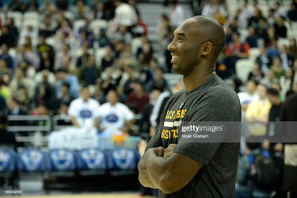 Kobe Bryant of the Los Angeles Lakers looks on during Fan Appreciation Day as part of the 2013 Global Games on October 17, 2013 at the Oriental Sports Center in Shanghai, China.