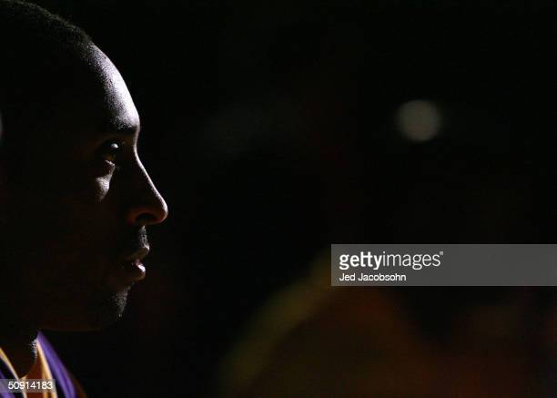 Kobe Bryant of the Los Angeles Lakers looks on during introductions before taking on the Minnesota Timberwolves in Game six of the Western Conference...