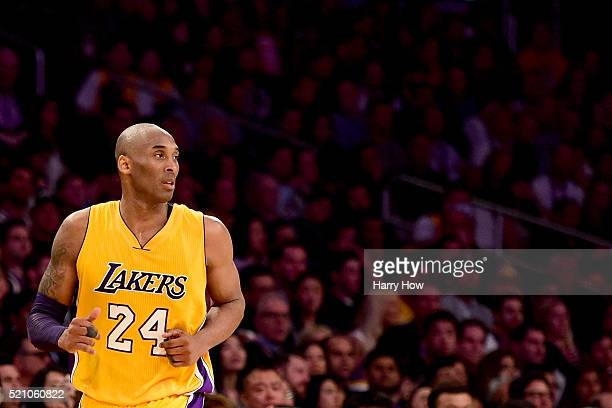 Kobe Bryant of the Los Angeles Lakers looks on in the fourth quarter against the Utah Jazz at Staples Center on April 13 2016 in Los Angeles...