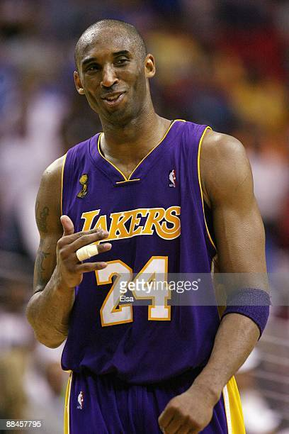 Kobe Bryant of the Los Angeles Lakers looks on with a smile in Game Four of the 2009 NBA Finals against the Orlando Magic at Amway Arena on June 11,...
