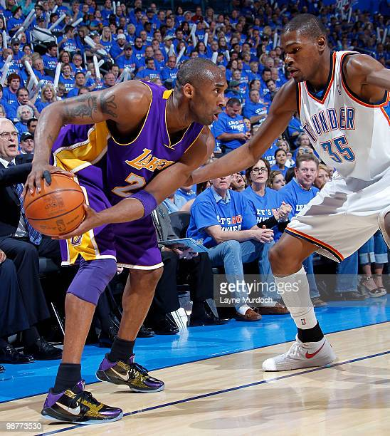 Kobe Bryant of the Los Angeles Lakers looks to drive to the basket against Kevin Durant of the Oklahoma City Thunder in Game Six of the Western...