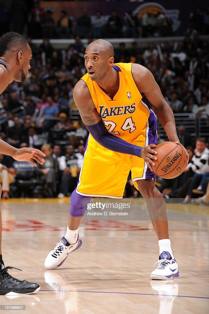 Kobe Bryant #24 of the Los Angeles Lakers looks to make a move against Sam Young #4 of the Indiana Pacers at Staples Center on November 27, 2012 in Los Angeles, California.