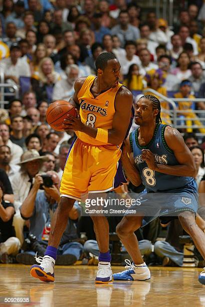 Kobe Bryant of the Los Angeles Lakers looks to play the ball against Latrell Sprewell of the Minnesota Timberwolves in Game six of the Western...