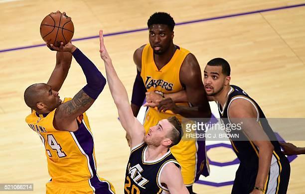 Kobe Bryant of the Los Angeles Lakers looks to shoot under pressure from Gordon hayward of the Utah Jazz in their seasonending NBA western division...