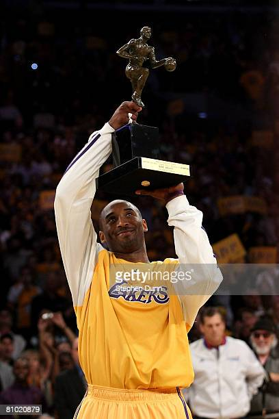 Kobe Bryant of the Los Angeles Lakers looks up at the MVP Trophy before the start of Game Two of the Western Conference Semifinals against the Utah...