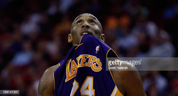 Kobe Bryant of the Los Angeles Lakers looks up to the scoreboard during their game against the Houston Rockets at Toyota Center on January 8 2013 in...