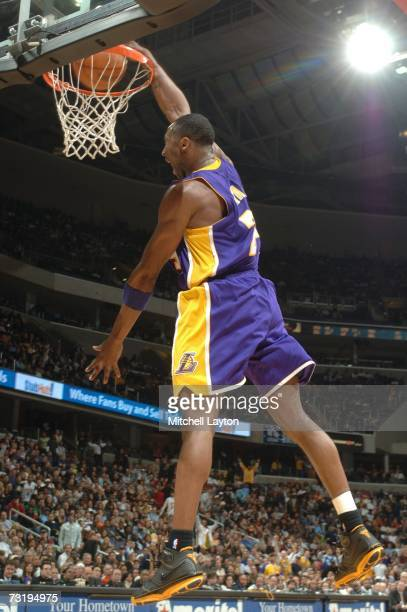 Kobe Bryant of the Los Angeles Lakers makes a dunk against the Washington Wizards in a NBA basketball game at the Verizon Center February 3 2007 in...