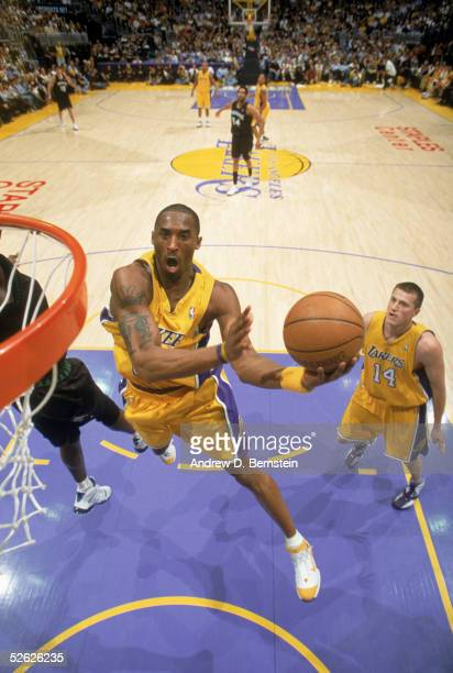 Kobe Bryant of the Los Angeles Lakers makes a layup against the Minnesota Timberwolves at Staples Center on March 31 2005 in Los Angeles California...