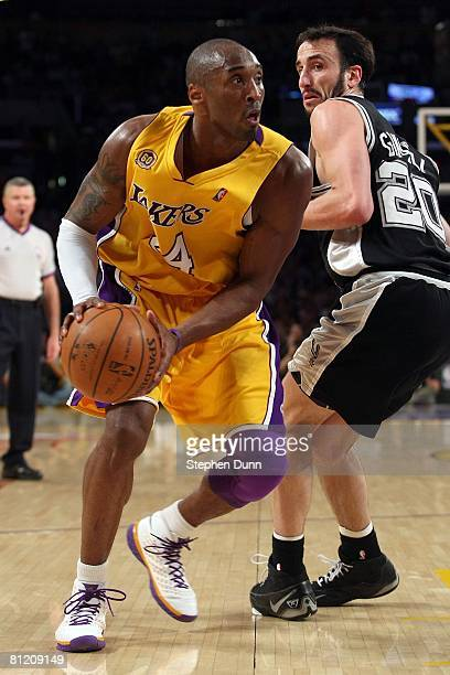 Kobe Bryant of the Los Angeles Lakers makes a move on Manu Ginobili of the San Antonio Spurs in Game One of the Western Conference Finals during the...