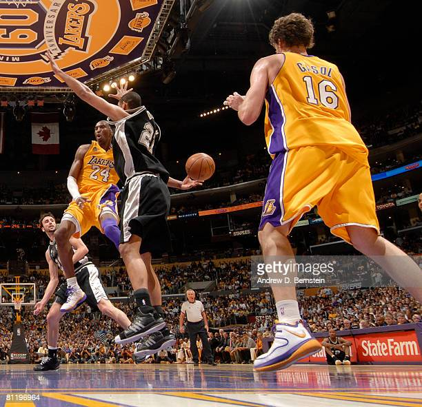 Kobe Bryant of the Los Angeles Lakers makes a pass to teammate Pau Gasol around Tim Duncan of the San Antonio Spurs in Game One of the Western...
