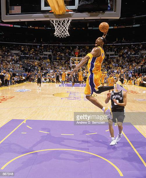 Kobe Bryant of the Los Angeles Lakers makes a slam dunk in game two of the Western Conference Semifinals during the 2002 NBA Playoffs against the the...