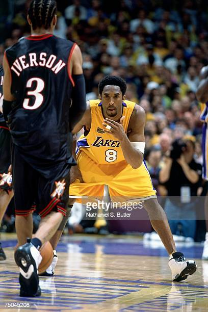 Kobe Bryant of the Los Angeles Lakers matches up against Allen Iverson of the Philadelphia 76ers during a 2001 NBA game at the Forum in Los Angeles...