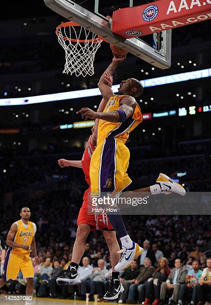 Kobe Bryant of the Los Angeles Lakers misses a dunk as he is guarded by Chandler Parsons of the Houston Rockets at Staples Center on April 6 2012 in...