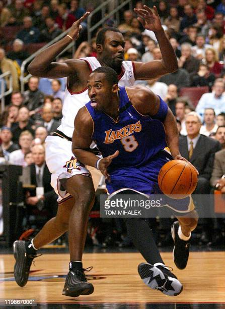 Kobe Bryant of the Los Angeles Lakers moves past Aaron McKie of the Philadelphia 76ers during the first period of their game 20 December 2002 at the...