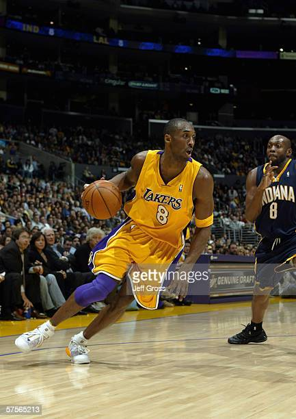 Kobe Bryant of the Los Angeles Lakers moves the ball against Anthony Johnson of the Indiana Pacers during the game at Staples Center on January 9...