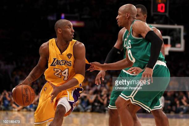 Kobe Bryant of the Los Angeles Lakers moves the ball against Ray Allen and Glen Davis of the Boston Celtics in Game Seven of the 2010 NBA Finals at...
