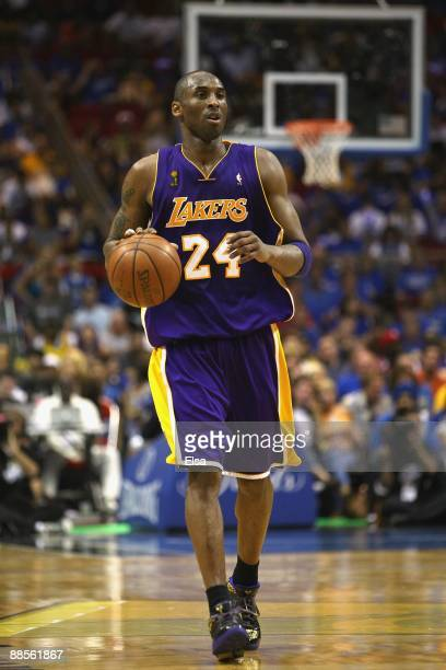 Kobe Bryant of the Los Angeles Lakers moves the ball against the Orlando Magic in Game Five of the 2009 NBA Finals on June 14 2009 at Amway Arena in...