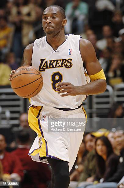 Kobe Bryant of the Los Angeles Lakers moves the ball during the game against the New Jersey Nets at Staples Center on November 27 2005 in Los Angeles...