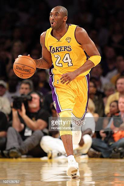 Kobe Bryant of the Los Angeles Lakers moves the ball in the first half while taking on the Boston Celtics in Game Six of the 2010 NBA Finals at...