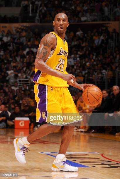 Kobe Bryant of the Los Angeles Lakers moves the ball up court against the Houston Rockets in Game Five of the Western Conference Semifinals during...