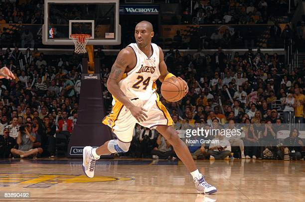 Kobe Bryant of the Los Angeles Lakers moves the ball up court during the game against the Sacramento Kings at Staples Center on November 23 2008 in...