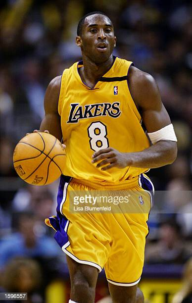 Kobe Bryant of the Los Angeles Lakers moves the ball upcourt during the game against the Portland Trail Blazers at Staples Center on November 3, 2002...