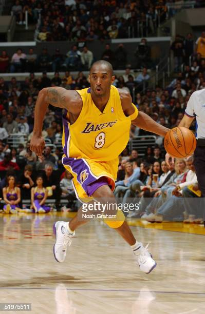 Kobe Bryant of the Los Angeles Lakers moves upcourt against the Toronto Raptors during the game at Staples Center on December 28 2004 in Los Angeles...