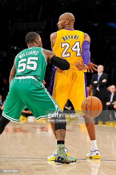 Kobe Bryant of the Los Angeles Lakers nolook passes the ball behind his back against Terrence Williams of the Boston Celtics at Staples Center on...