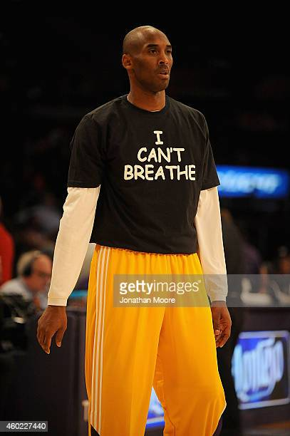 Kobe Bryant of the Los Angeles Lakers on the court before a game against the Sacramento Kings at Staples Center on December 9 2014 in Los Angeles...