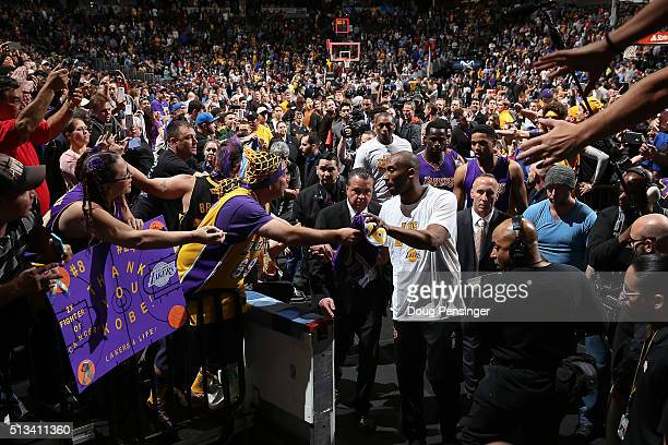 Kobe Bryant of the Los Angeles Lakers passes through a sea of fans as he leaves the court after facing the Denver Nuggets at Pepsi Center on March 2...